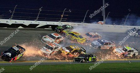Jimmie Johnson (48) goes low to avoid a multi-car crash involving, Alex Bowman (88), Denny Hamlin (11), Chase Elliott (9), Kurt Busch (41), Joey Logano (22), Daniel Suarez (19), Austin Dillon (3) and Kasey Kahne in the NASCAR Cup Series auto race at Daytona International Speedway, in Daytona Beach, Fla