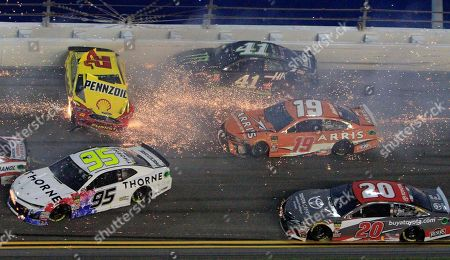 Joey Logano (22) hits the wall as he is involved in a multi-car crash also involving Kasey Kahne (95), Kurt Busch (41), Daniel Suarez (19), Erik Jones (20) and others during the NASCAR Cup Series auto race at Daytona International Speedway, in Daytona Beach, Fla