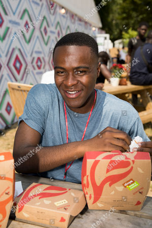 Bake Off's Liam Charles tucked into some Peri-Peri chicken backstage at Wireless Festival with Nando's