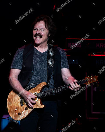 American iconic rock band The Doobie Brothers with lead guitarist and founding member Tom Johnston perform at the Xfinity Center, in Mansfield, Mass