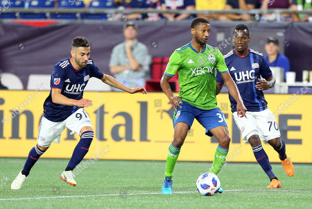 , 2018; Foxborough, MA, USA; Seattle Sounders FC defender Jordan McCrary (30), New England Revolution defender Gabriel Somi (91) and New England Revolution forward Cristian Penilla (70) in action during an MLS match between Seattle Sounders FC and New England Revolution at Gillette Stadium. The match ended in a 0-0 draw