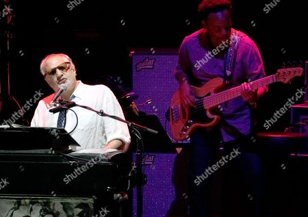 American rock band Steely Dan, featuring founder and keyboardist Donald Fagen, left, performs at the Xfinity Center, in Mansfield, Mass