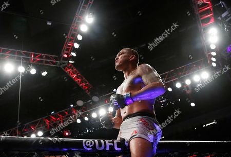 Anthony Pettis celebrates after defeating Michael Chiesa in a lightweight mixed martial arts bout at UFC 226, in Las Vegas