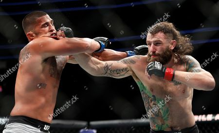 Michael Chiesa hits Anthony Pettis during a lightweight mixed martial arts bout at UFC 226, in Las Vegas