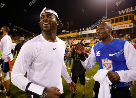 Roadrunners' Michael Vick, left, and Ocho's Chad Ochocinco after Ocho won their semifinal game at the American Flag Football League (AFFL) U.S. Open of Football tournament, in Kennesaw, Ga