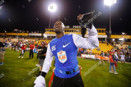 Ocho's Chad Ochocinco celebrates after his team won their semifinal game against Roadrunners at the American Flag Football League (AFFL) U.S. Open of Football tournament, in Kennesaw, Ga