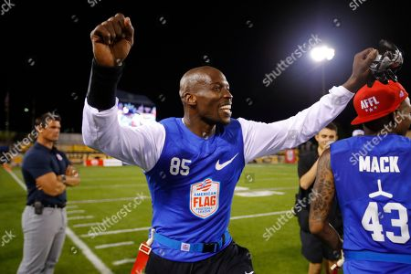 Ocho's Chad Ochocinco celebrates his team's semifinal win at the American Flag Football League (AFFL) U.S. Open of Football tournament, in Kennesaw, Ga