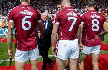 Galway vs Kilkenny. Michael D Higgins, President of Ireland meets Gearoid McInerney and Aidan Harte of Galway