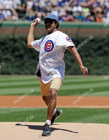 Actor Jay Chandrasekhar throws out a ceremonial first pitch before a baseball game between the Cincinnati Reds and the Chicago Cubs, in Chicago