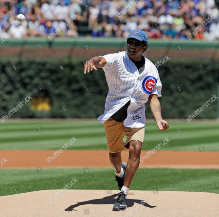 Stock Image of Actor Jay Chandrasekhar throws out a ceremonial first pitch before a baseball game between the Cincinnati Reds and the Chicago Cubs, in Chicago