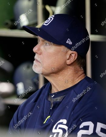San Diego Padres bench coach Mark McGwire (25) in the first inning during a baseball game against the Arizona Diamondbacks, in Phoenix