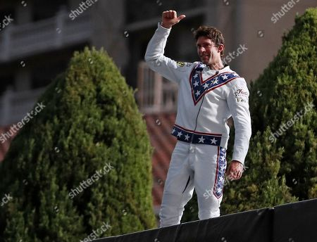 Travis Pastrana celebrates after jumping the fountain at Caesars Palace on a motorcycle, in Las Vegas. Pastrana recreated three of Evel Knievel's iconic motorcycle jumps on Sunday, including the leap over the fountains of Caesars Palace that left Knievel with multiple fractures and a severe concussion