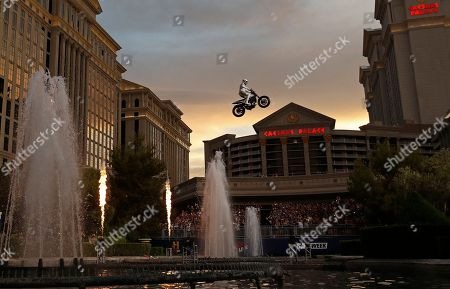 Travis Pastrana jumps the fountain at Caesars Palace on a motorcycle, in Las Vegas. Pastrana recreated three of Evel Knievel's iconic motorcycle jumps on Sunday, including the leap over the fountains of Caesars Palace that left Knievel with multiple fractures and a severe concussion