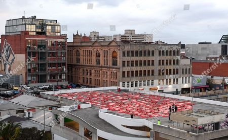 People participate in a photo shoot for contemporary New York artist Spencer Tunick, as he photographs nude Melburnians for his latest piece, 'Return of the Nude', for part of Chapel Street Prahran's Provocare festival in Melbourne, Australia, 09 July 2018.