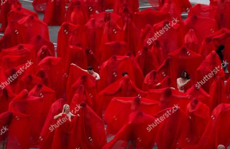 Stock Photo of People participate in a photo shoot for contemporary New York artist Spencer Tunick, as he photographs nude Melburnians for his latest piece, 'Return of the Nude', for part of Chapel Street Prahran's Provocare festival in Melbourne, Australia, 09 July 2018.