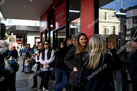 People watch on as contemporary New York artist Spencer Tunick photographs nude Melburnians for his latest piece, 'Return of the Nude', as part of Chapel Street Prahran's Provocare festival in Melbourne, Australia, 09 July 2018.