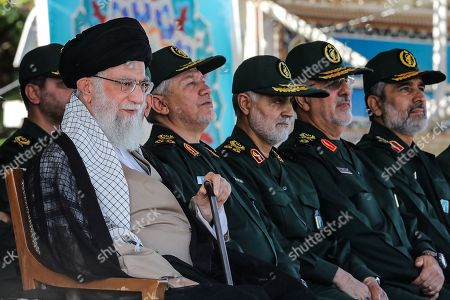 Stock Picture of Major General Qasem Soleimani,(C) the commander of Quds Force, the Islamic Revolutionary Guard Corps (IRGC), Iranian Supreme Leader Ayatollah Seyyed Ali Khamenei attended the graduation ceremony of The IslamicRevolutionary Guard Corps (IRGC), held at the military cadets Imam Hussain (a.s.) Officers Academy