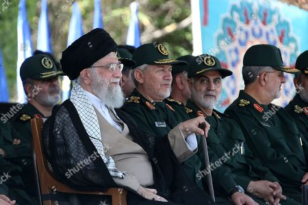 Stock Image of Major General Qasem Soleimani,(C) the commander of Quds Force, the Islamic Revolutionary Guard Corps (IRGC), Iranian Supreme Leader Ayatollah Seyyed Ali Khamenei attended the graduation ceremony of The Islamic Revolutionary Guard Corps (IRGC), held at the military cadets Imam Hussain (a.s.) Officers Academy