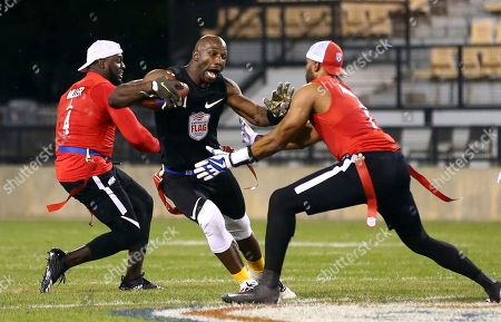 Godspeed's Jason Avant tries to avoid the flag pull during a semifinal game against Holdat at the American Flag Football League (AFFL) U.S. Open of Football tournament, in Kennesaw, Ga