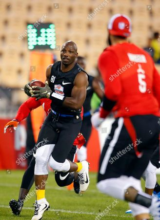 Godspeed's Jason Avant runs with the ball in a semifinal game against Holdat at the American Flag Football League (AFFL) U.S. Open of Football tournament, in Kennesaw, Ga