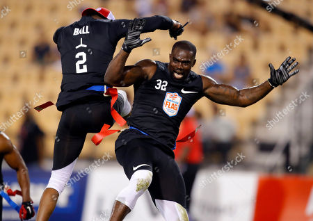 Godspeed's Alan Ball, left, and Godspeed's James Ihedigbo celebrate during their semifinal game against Holdat at the American Flag Football League (AFFL) U.S. Open of Football tournament, in Kennesaw, Ga