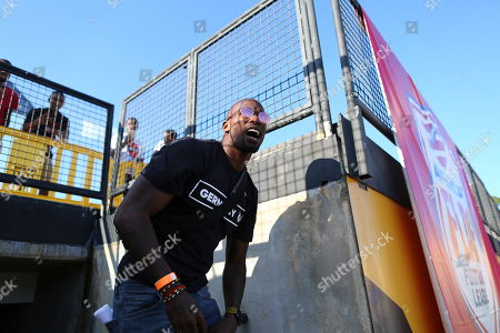 Chad Ochocinco comes out onto the field during the American Flag Football League (AFFL) U.S. Open of Football tournament, in Kennesaw, Ga