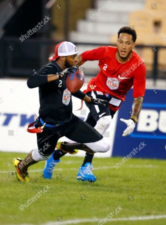 Godspeed's Alan Ball, left, is pursued by Holdat's Austin Pettis during a semifinal game of the American Flag Football League (AFFL) U.S. Open of Football tournament, in Kennesaw, Ga