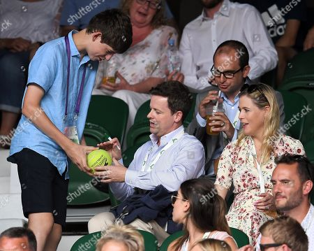 Declan Donnelly signs his autograph sat next to Ali Astall on Centre Court