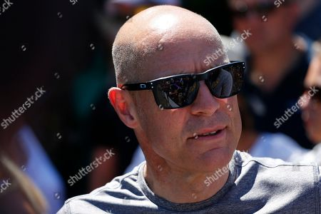 Team Sky manager Sir Dave Brailsford talk to an acquaintance prior to the third stage of the Tour de France cycling race, a team time trial over 35.5 kilometers (22 miles) with start and finish in Cholet, France