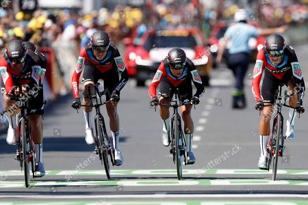 BMC Racing Team riders Tejay van Garderen of the US (2-L), Richie Porte of Australia (2-R) and Greg van Avermaet of Belgium (R) during the 35.5km team Time trial in the 3rd stage of the 105th edition of the Tour de France cycling race in Cholet, France, 09 July 2018.