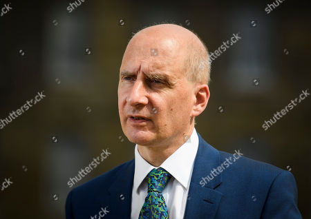 Lord Adonis is seen speaking to media in Westminster about the resignation of former Brexit Secretary David Davis.