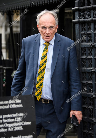 Eurosceptic Conservative MP Peter Bone is seen leaving The Houses of Parliament in London following the resignation of former Brexit Secretary David Davis.