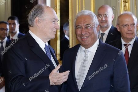 The spiritual leader of Shia Imami Ismaili Muslims, Prince Karim Aga Khan (L) is welcomed by Portuguese Prime Minister Antonio Costa (C), before a lunche at Foz Palace in Lisbon, Portugal, 09 July 2018.