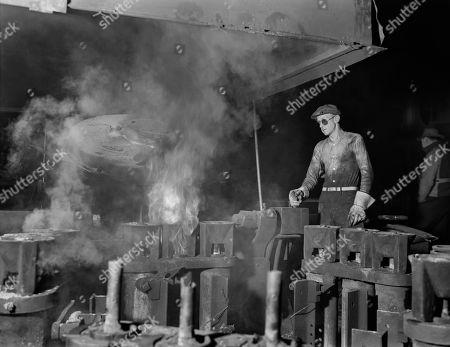 Operator of Electric Furnace Pouring Molten Metal into Molds, Chase Brass and Copper Company, Euclid, Ohio, USA, Alfred T. Palmer for office of War Information, February 1942