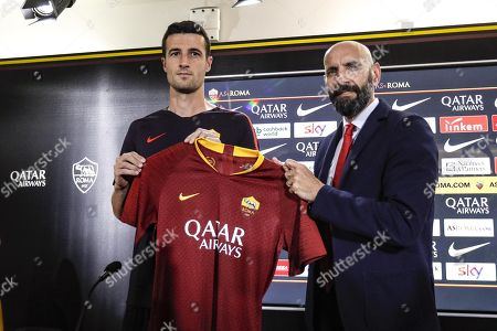 AS Roma's sports director Ramon Rodriguez Verdejo (R), known as Monchi, attend a press conference for the presentation of Spanish Ivan Marcano (L) in Trigoria, Rome, Italy, 9 July 2018.