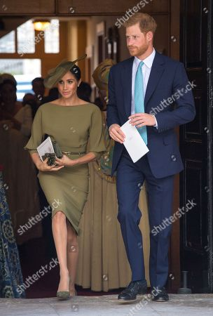 Prince Harry and Meghan Duchess of Sussex depart after attendingthe christening of Prince Louis at the Chapel Royal, St James's Palace