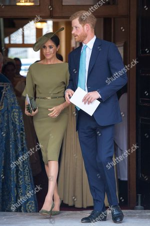 Prince Harry and Meghan Duchess of Sussex depart after attending the christening of Prince Louis at the Chapel Royal, St James's Palace