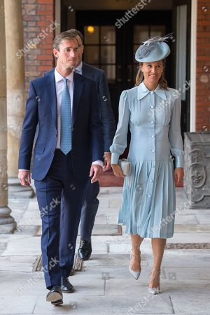 Pippa Middleton and her husband James Matthews arriving for the christening of Prince Louis, the youngest son of the Duke and Catherine Duchess of Cambridge at the Chapel Royal, St James's Palace