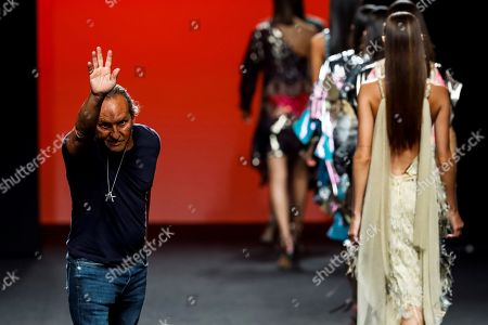 Spanish designer Custo Dalmau (L) greets audience during the presentation of his creations for Spanish fashion brand Custo Barcelona at the 68th Mercedes-Benz Fashion Week Madrid (MBFWM) Spring-Summer 2019, in Madrid, Spain, 09 July 2018. The event runs from 06 to 11 July.