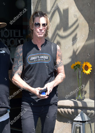 Duff McKagan comes out of the hotel