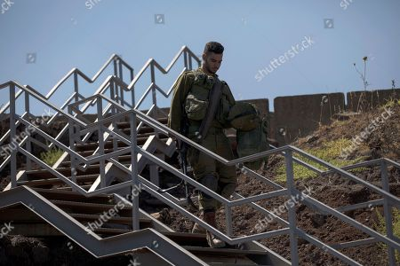 An Israeli soldier walks down a staircase during a visit of Israeli Defense Minister Avigdor Lieberman to the Israeli-Syrian border in the Golan Heights, 10 July 2018. Lieberman paid a visit to the Israeli occupied Golan Heights to send a message towards Syria. Her is quoted by media giving a warning to all organizations allegedly associated with Iranian militias who seek to allegedly establish a terror network in the Golan Heights, and rejecting any intake of refugees.
