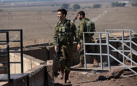 Israeli soldiers monitor the area during a visit by Defense Minister Lieberman to the Israeli-Syrian border in the Golan Heights, 10 July 2018. Lieberman paid a visit to the Israeli occupied Golan Heights to send a message towards Syria. Her is quoted by media giving a warning to all organizations allegedly associated with Iranian militias who seek to allegedly establish a terror network in the Golan Heights, and rejecting any intake of refugees.