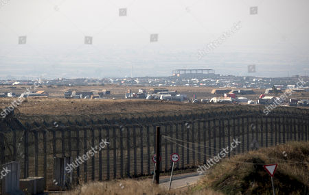 A general view to a Syrian refugee tent camp near the Israeli-Syrian border, as seen from the Israeli side of the border in the Golan Heights, 10 July 2018. Lieberman paid a visit to the Israeli occupied Golan Heights to send a message towards Syria. He is quoted by media giving a warning to all organizations allegedly associated with Iranian militias who seek to allegedly establish a terror network in the Golan Heights, and rejecting any intake of refugees.