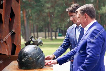 Canadian Prime Minister Justin Trudeau (L) and Latvian Prime Minister Maris Kucinskis during Trudeau visit to Adazi Military Base, Latvia, 10 July 2018. Canadian Prime Minister Justin Trudeau visited Canadian-led NATO's Enhanced Forward Presence battle in Latvia ahead of the NATO summit in Brussels, Belgium, that lasts from 11 to 12 July 2018.