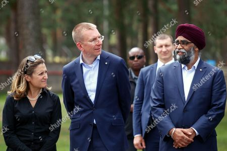 Canadian Minister of Defence Harjit Sajjan (R), Latvian Minister of Foreign Affairs Edgars Rinkevics and Canadian Foreign minister Chrystia Freeland (L) during Canadian Prime Minister Justin Trudeau (not pictured) visit to Adazi Military Base, Latvia, 10 July 2018. Canadian Prime Minister Justin Trudeau visited Canadian-led NATO's Enhanced Forward Presence battle in Latvia ahead of the NATO summit in Brussels, Belgium, that lasts from 11 to 12 July 2018.