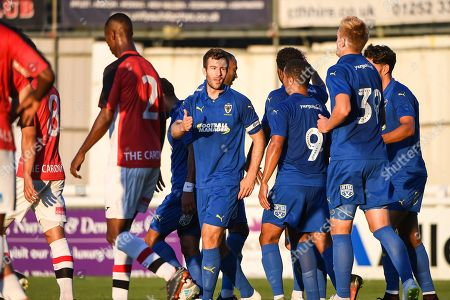 AFC Wimbledon Defender Jonathan Meades (3) celebrates scoring a goal (3-0) during the Pre-Season Friendly match between Woking and AFC Wimbledon at the Kingfield Stadium, Woking. Picture by Stephen Wright