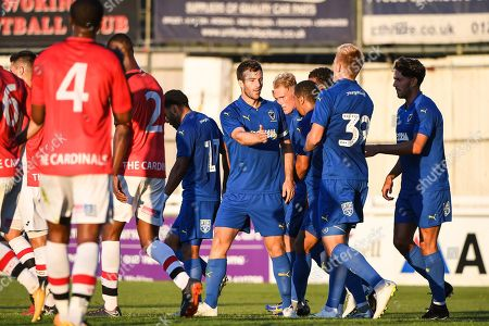 Stock Photo of AFC Wimbledon Defender Jonathan Meades (3) celebrates scoring a goal (3-0) during the Pre-Season Friendly match between Woking and AFC Wimbledon at the Kingfield Stadium, Woking. Picture by Stephen Wright