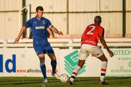 Stock Picture of AFC Wimbledon Defender Jonathan Meades (3) and Woking Defender Louis Ramsay (2) in action during the Pre-Season Friendly match between Woking and AFC Wimbledon at the Kingfield Stadium, Woking. Picture by Stephen Wright
