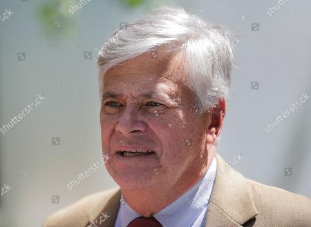 """Dean Skelos leaves federal court in New York, . The former New York state Senate leader and his son got business executives to arrange no-show jobs for the son in a brazen """"family shakedown"""" that corrupted the senator's office, a federal prosecutor said Tuesday at the retrial of the pair on bribery and extortion charges"""