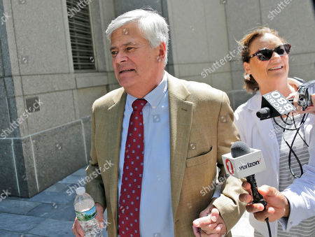 """Dean Skelos leaves federal court with his wife Gail Skelos in New York, . The former New York state Senate leader and his son got business executives to arrange no-show jobs for the son in a brazen """"family shakedown"""" that corrupted the senator's office, a federal prosecutor said Tuesday at the retrial of the pair on bribery and extortion charges"""